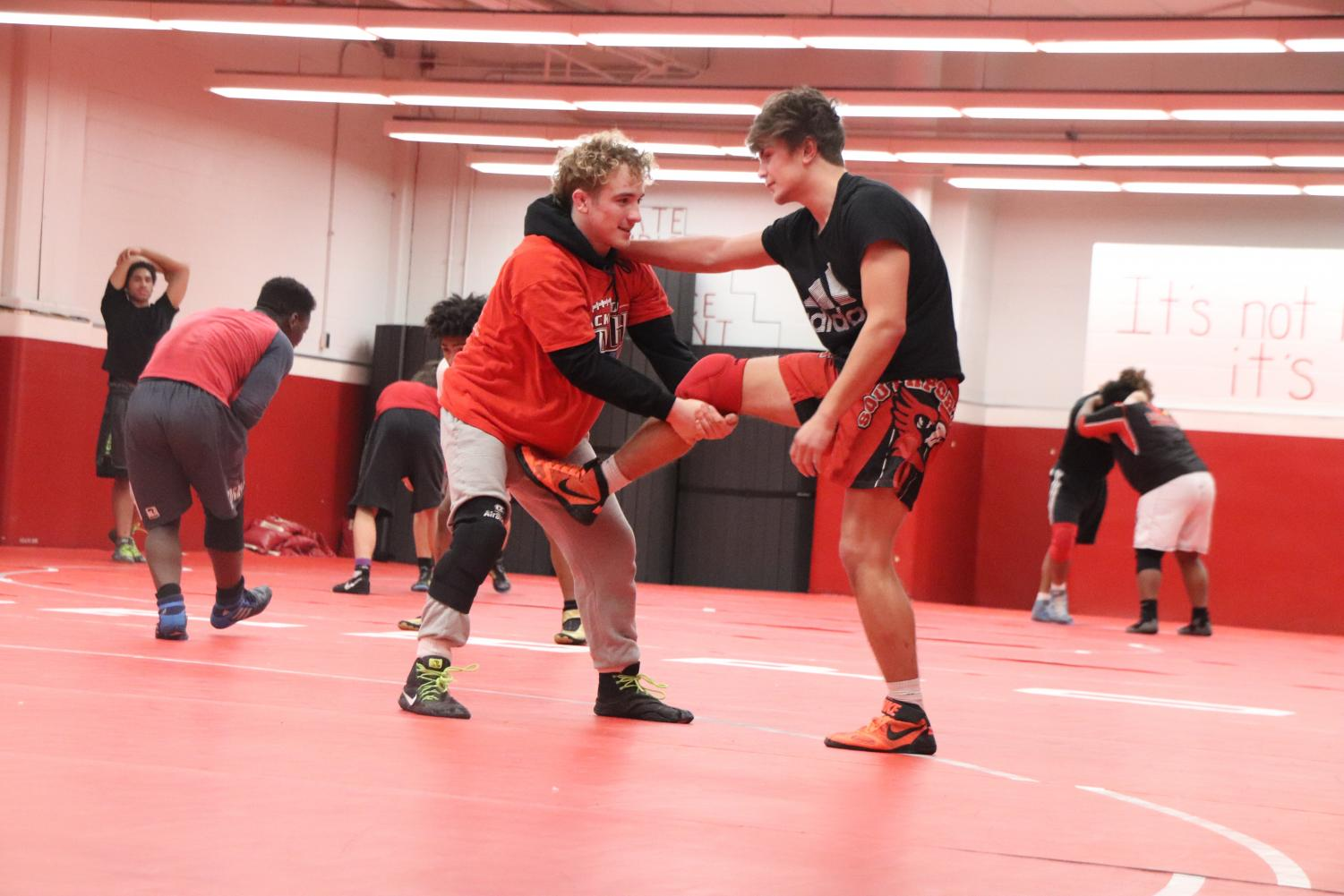 Luke Goodwin and senior Josh Moore practice with each other on Jan. 30. Goodwin won first place in conference on Jan. 18.
