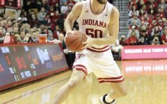 Joey Brunk looks for an opening in the defense against the University of Iowa on Feb. 13. Indiana University won with a final score of 89-77.