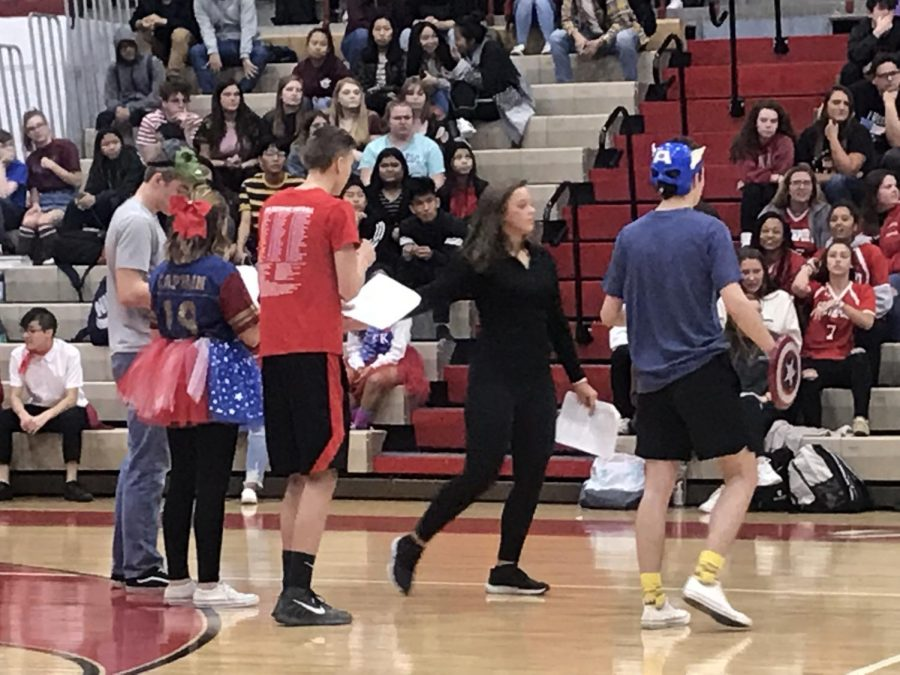 Booster club officers do their skit at a pep session.