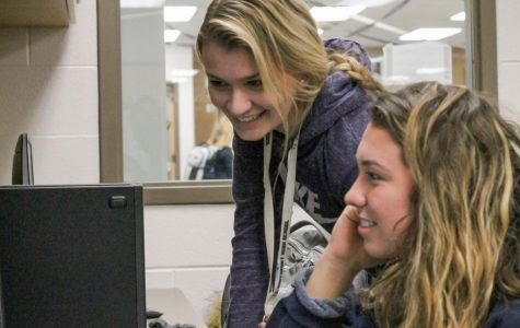 Seniors Olivia Scaggs and Keirstin Piatt work on pages. The title for this year's edition is