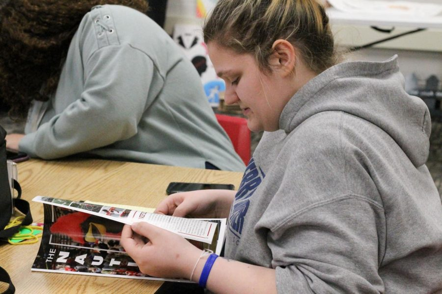 Junior Jessica Lemons flips through last year's spring magazine. Each year the yearbook produces a spring magazine to produce the most coverage possible after finishing the book.