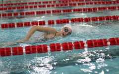 Senior Megan Frank competes in a 500 relay on Jan. 16.