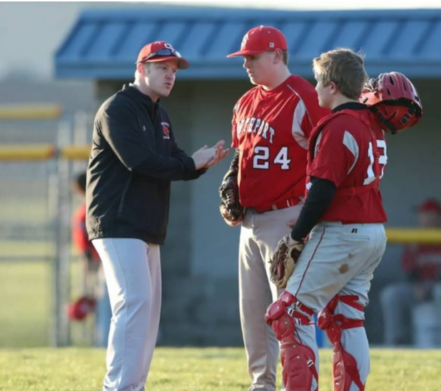 Daniel Jones coaches some of the players on his team. Jones was offered the job as assistant baseball coach while working as an instructional aide at SHS.