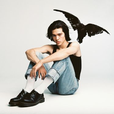 The album cover is Gray pictured sitting with a crow above his head. Released in 2020, it debuted as the biggest US new artist debut.