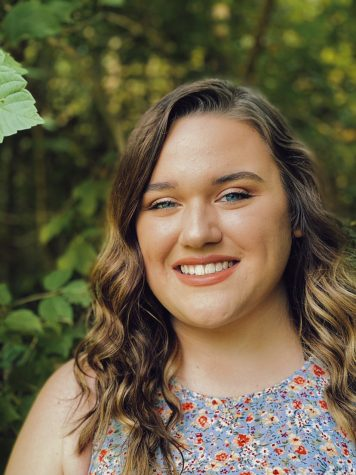 Junior Emily Rusaw is pictured in her senior photos. She is graduating a year early.