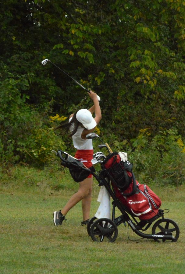 Annika Chan swings away at regionals. She and her sister Naomi Chan both made it to the girls golf regional tournament.