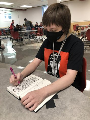 unior Heidi McMullen draws one of her characters during her lunch period on Sept. 25. McMullen says that drawing calms her nerves.