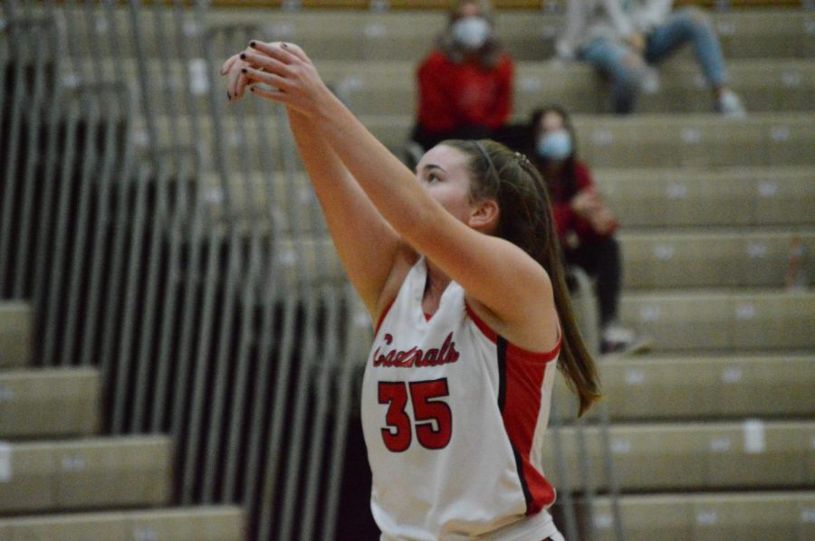 Senior Maddy Newhouse follows through after shooting a free throw.
