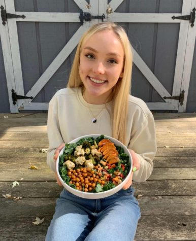 "Junior Aija Bowman is holding one of her vegan meals. She calls it a ""Nourish Bowl."""