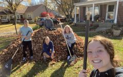 Riley Dance Marathon members sophomore Ben Henderson, junior Emma Meredith, senior Keely Sullivan, senior Jacob Kinney and junior Ellie Brown rake yards on Nov. 5. Raking for Riley was used to raise money for the organization.