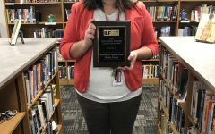 Media specialist Tara Foor holds the award. SHS competed with other schools around the state for the award.