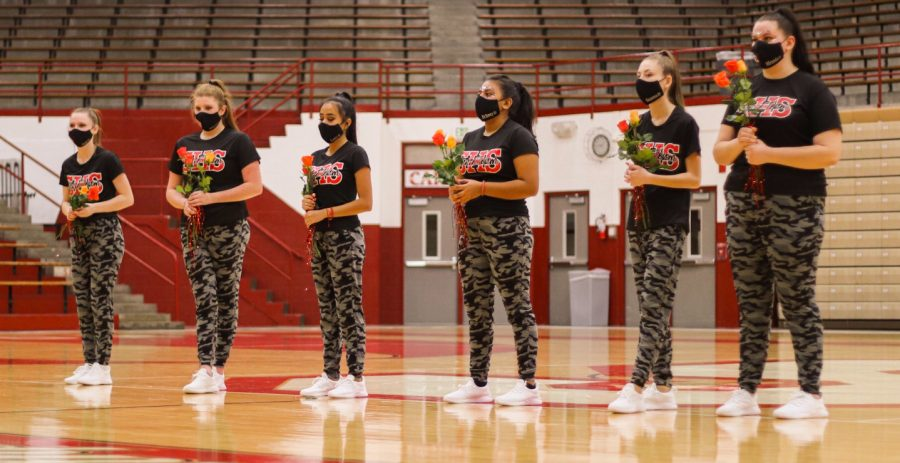 SHS dance team has a final showcase in their home gym. Pictured here are the dances receiving congratulatory flowers.