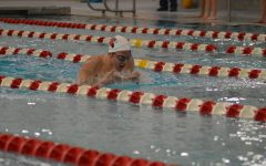 Senior Daniel Hiller performs the breaststroke during the third pass of the 200 yard IM. Hiller decided to go all-virtual to avoid being quarantined during his season.