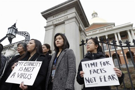 Protesters protest at the Statehouse of Boston on March 12, 2020. The rise in crimes against Asians stemming from the Corona virus have led to other protests around the country.