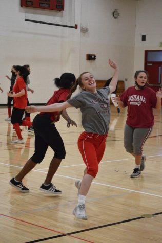 The SHS softball team plays tag as a fun way to condition during their practices. The Lady Cards take on Whiteland on April 1 for their season opener.