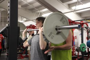 Track runner lifts weights to get ready for the team's first meet on April 6. After losing their indoor season this year, the track team has had offseason workouts in order to stay in shape.