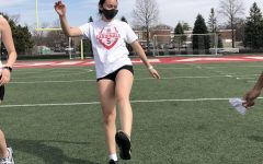 Sophomore Jackie Coy warms up before track practice. Track is just one of the many activities Coy has dedicated herself to.