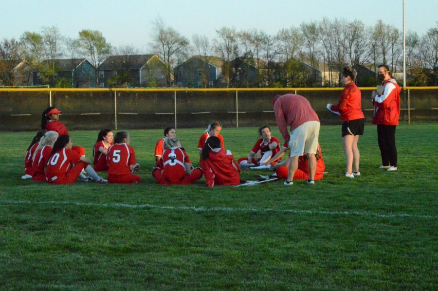 The girls softball team sits together and reflects on how game against Warren Central on April 12. This year, the softball team will have at least three games in each week.