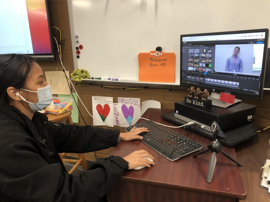 Junior Nilen Sung edits an upcoming announcement. She says that her editing skills have improved since the beginning of the school year.