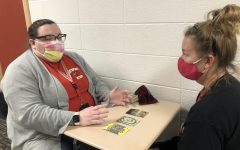 English teacher Paige Wyatt gives a reading to english teacher Dawn Fowerbaugh. Fowerbaugh wanted to know how her summer will go.