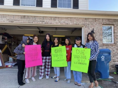 The members of YMA pose for a picture on the day of their yard sale. The Youth Movement Association was started by students from SHS in support of the crisis in Myanmar.