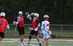 Seniors Griffin Thomas and Tristan Dyson celebrate after Dyson scores a goal. Dyson finished with three goals in the Cards' 20-7 win against Roncalli on May 7.