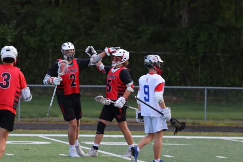Seniors Griffin Thomas and Tristan Dyson celebrate after Dyson scores a goal. Dyson finished with three goals in the Cards