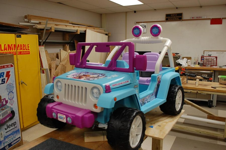 Robotics sponsor Mark Snodgrass wanted to create a program to help young Perry Township students with mobility issues. This car is the first car the program, called Mini Movers, has made.