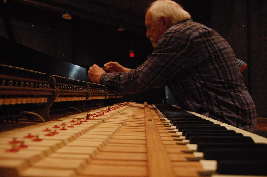 Repairman Ron Winter works on the Steinway piano at SHS in preparation for the orchestra concert on May 18.