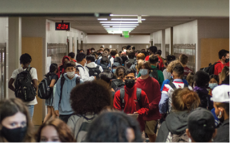 Students walk through the social studies hallway during passing period. SHS is now requiring masks during school.