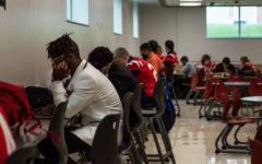 The SHS  varsity football players take time before their game against the Falcons to focus on their grades.