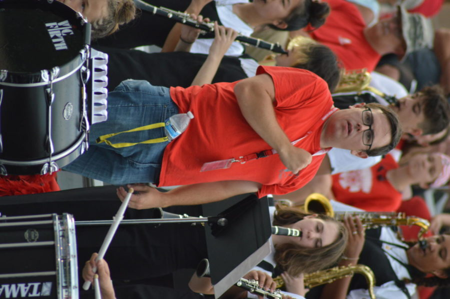 Band+teacher+Jeff+Maupin+indicates+to+the+Marching+Band+that+they+will+not+be+repeating+the+section+of+music+theyre+playing.+The+band+had+been+practicing+pep+band+music+in+anticipation+for+the+game.