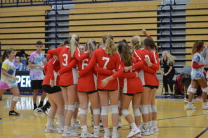 The SHS Lady Cards huddle around before an away game at PMHS. The Cards lost this bout 3-0.