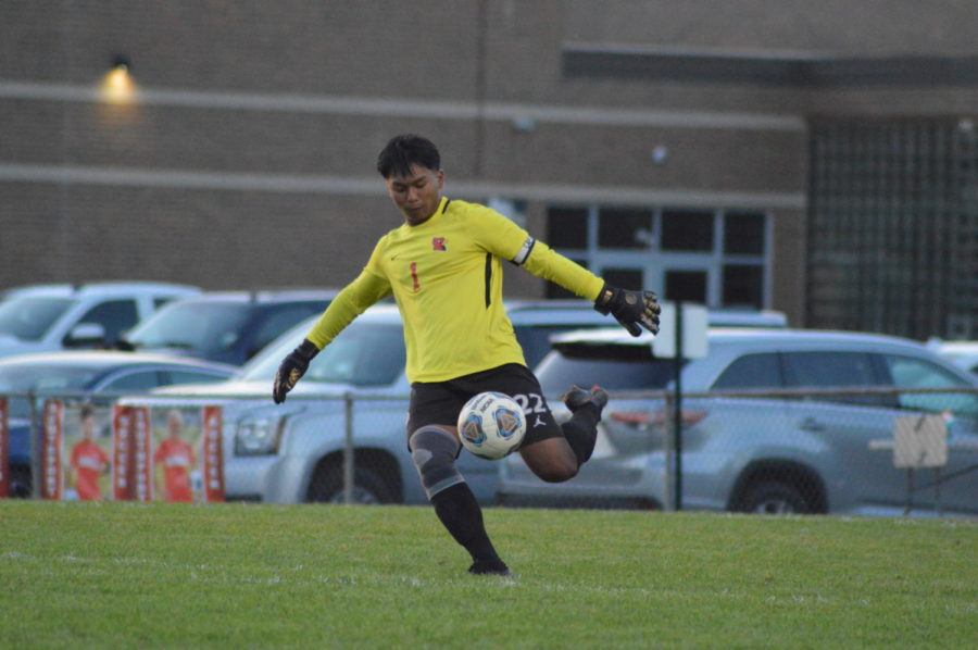Senior goalie Bi Chua kicks the ball toward the middle of the field after an attempted score by Franklin Central. The Cards lost to Franklin Central 4-1 on Sept. 16.