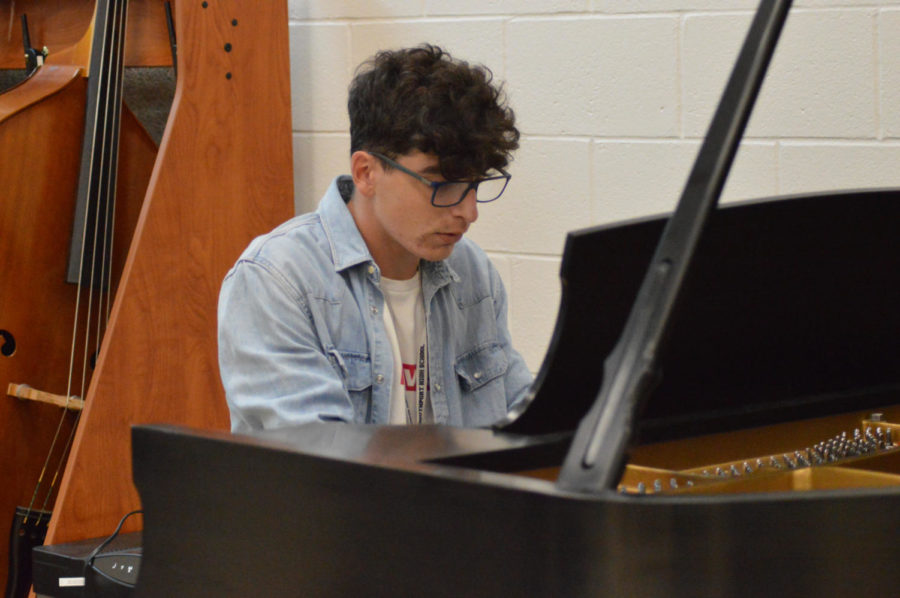 Junior Pablo Crémer plays a piece on the piano. He plays a variety of other instruments too.
