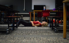 Senior Aija Bowman rests in her final pose of the session. This pose is called Shavasana.