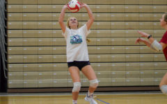 Chafin sets up her teammate with a set during practice