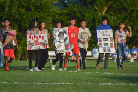 Thang walks out with his family and friends during the senior night ceremony on Sept. 16, before the game against Franklin Central