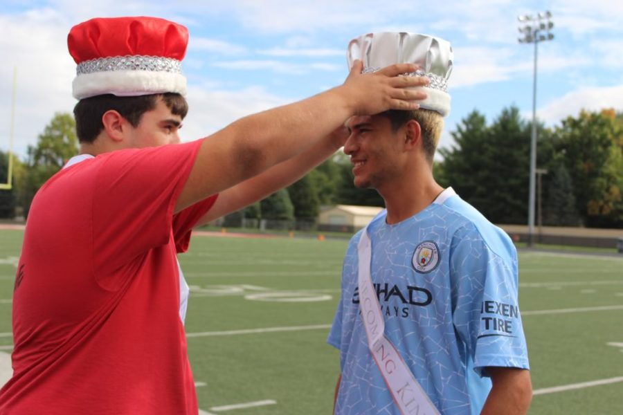 Senior Trevor Chambers crowns senior Hector Gonzalez-Loza. The two are sharing the title of homecoming king. Photo contributed by Stacey Matlock