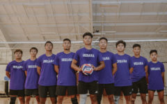 Khambawilian Thangngan standing alongside his team. This photo is used to represent their team.