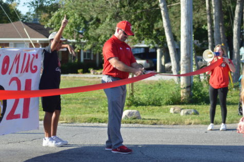 Bohannon cuts the ribbon to start the homecoming parade.